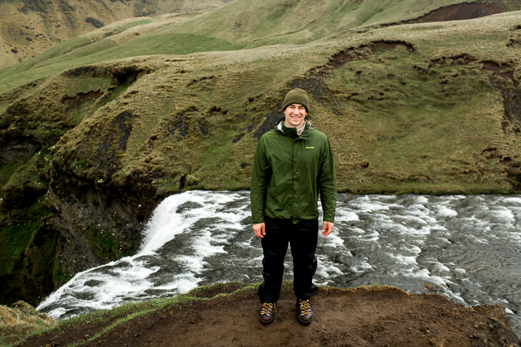 Man standing at the top of Skogafoss, Iceland