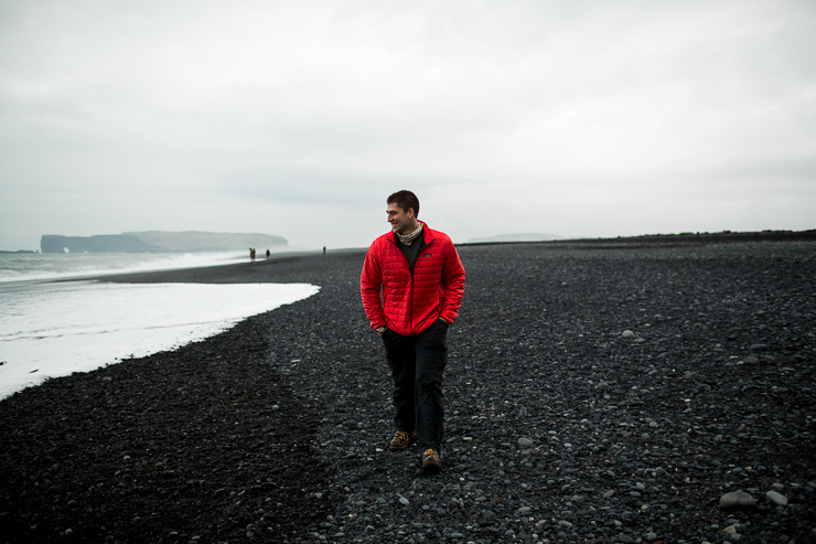 Man walking on the black beach, Reynisfjara near Vik, Iceland