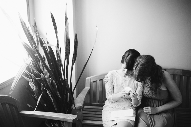 Bride crying reading a person note from her husband