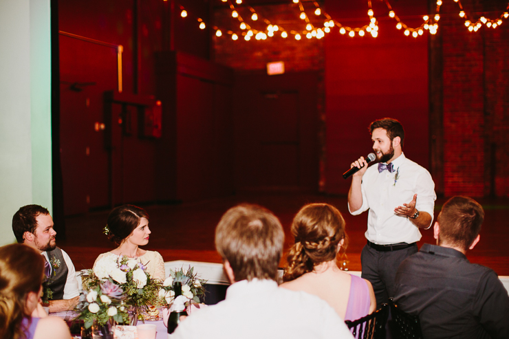 Bride and Groom listening to wedding toasts in Kansas City