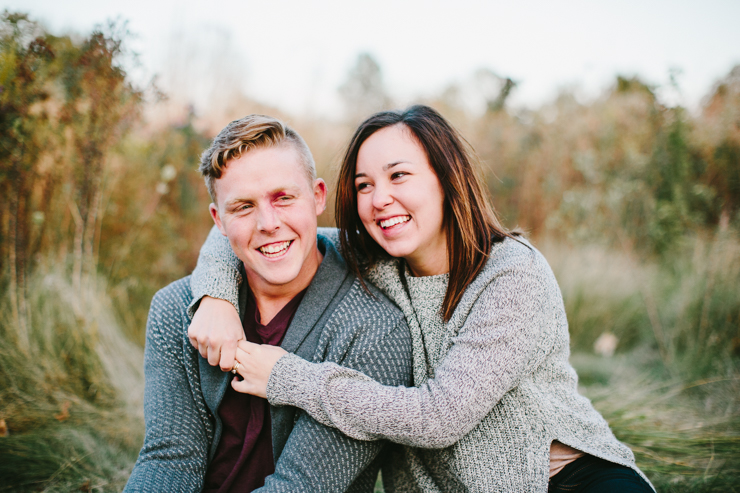 Engagement photos in a countryside field of flowers