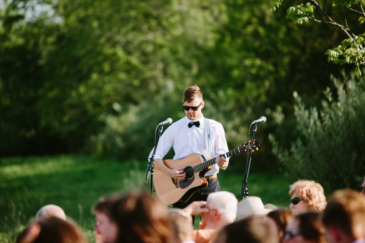 Guitar player for outdoor countryside wedding