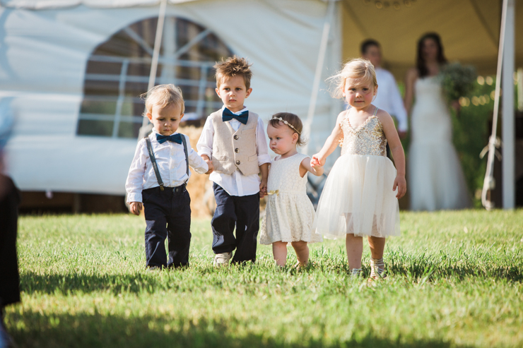 Ring Bearers and flowers girls walking down the aisle