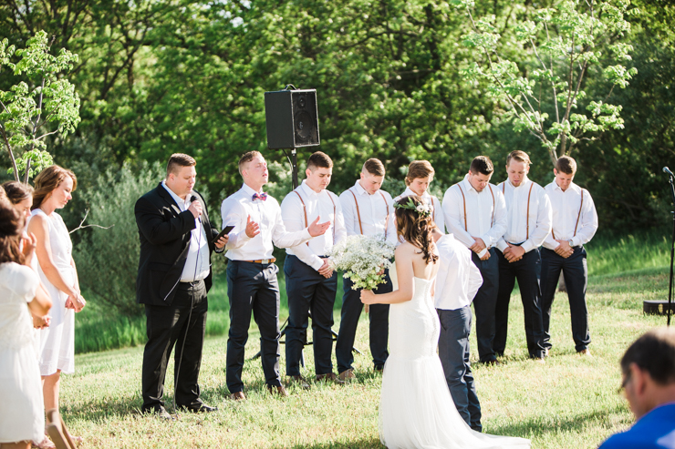 Groom worshipping as his bride walks down the aisle. Best groom's reaction ever to seeing his bride walk down the aisle for the first time
