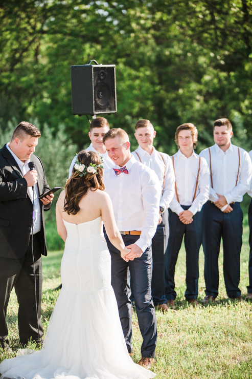 Outdoor rustic boho countryside wedding ceremony