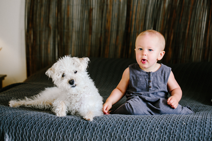 Lifestyle photography one year old and puppy on bed