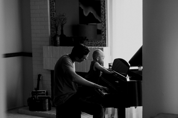 Father and one year old son playing the paino together photography in Colorado