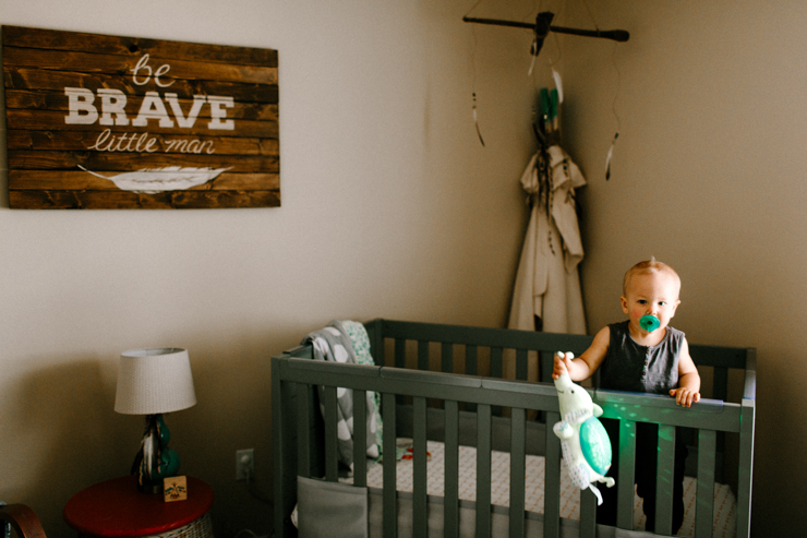 Lifestyle photography of baby in his crib Colorado