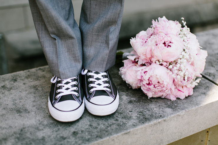 Groom wearing Sneakers with Bride's Bouquet