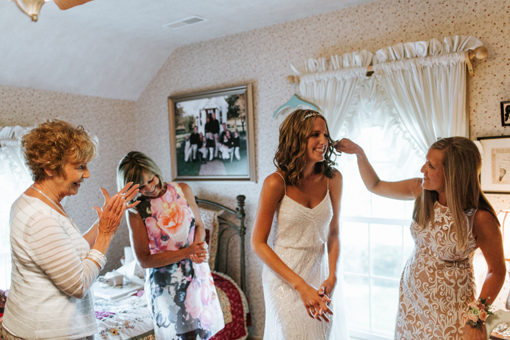 Bride getting ready with her bridesmaids at her grandparents' farm