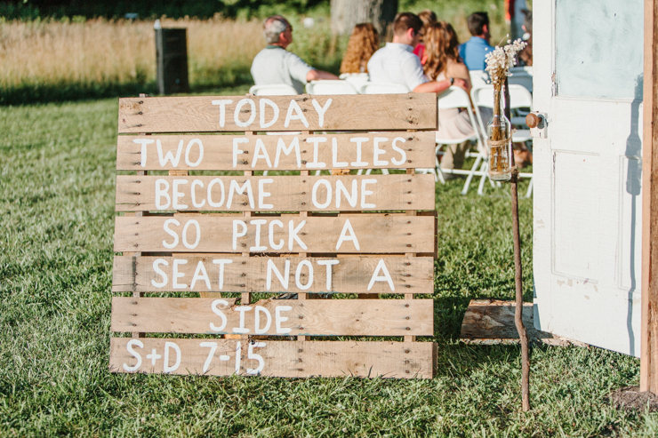 sign that says joining two families together so sit anywhere