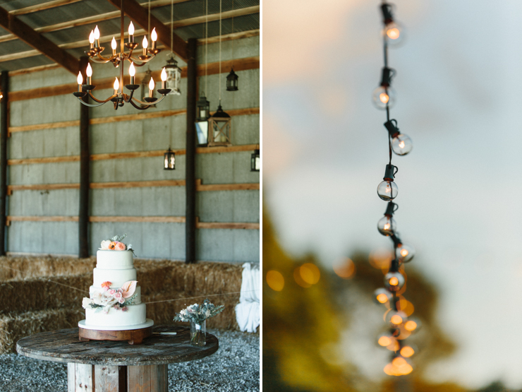 Barn wedding reception decor with cake and edison bulbs