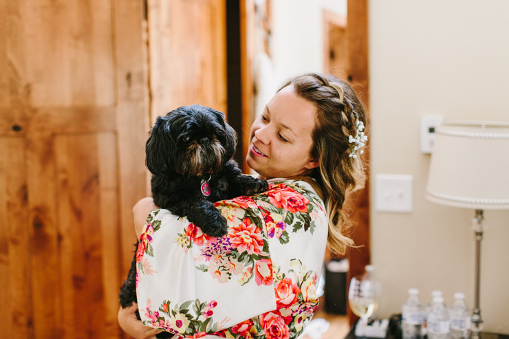 Bride with her lifelong family dog on her wedding day
