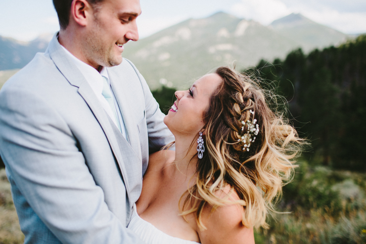 Bride and Groom photography overlooking the Rocky mountains at YMCA of the Rockies, Overlook Chapel Colorado