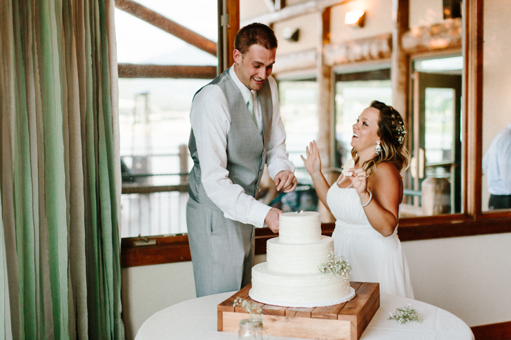 Bride and Groom cut their wedding cake at wedding reception at Estes Park Resort, Colorado
