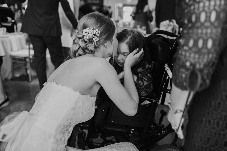 Bride kissing special needs cousin