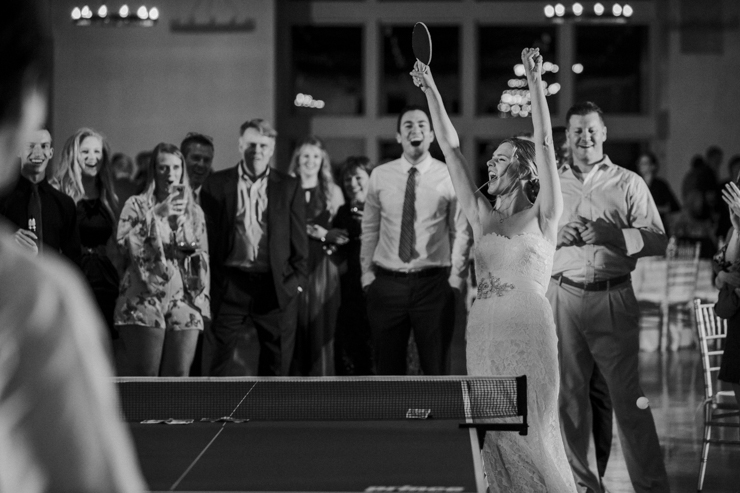 Bride Celebrating at Wedding Reception playing Ping Pong Pear Tree Estate Champaign, IL
