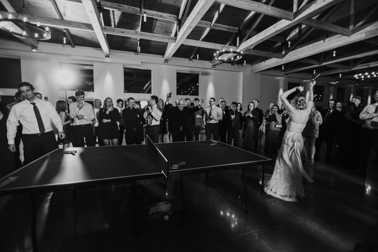 Bride and Groom Celebrating at Wedding Reception playing Ping Pong Pear Tree Estate Champaign, IL