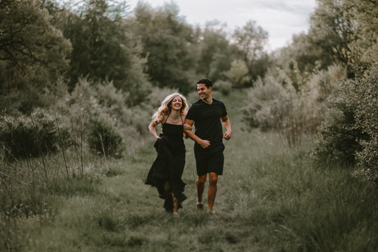 Moody portraits of a couple wearing boho free people clothing  in Illinois field