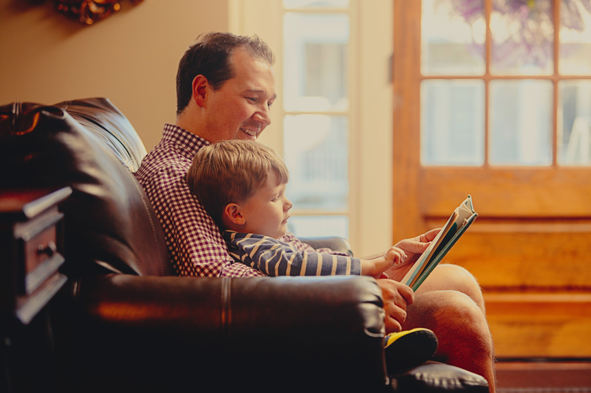Chris reading to his son.