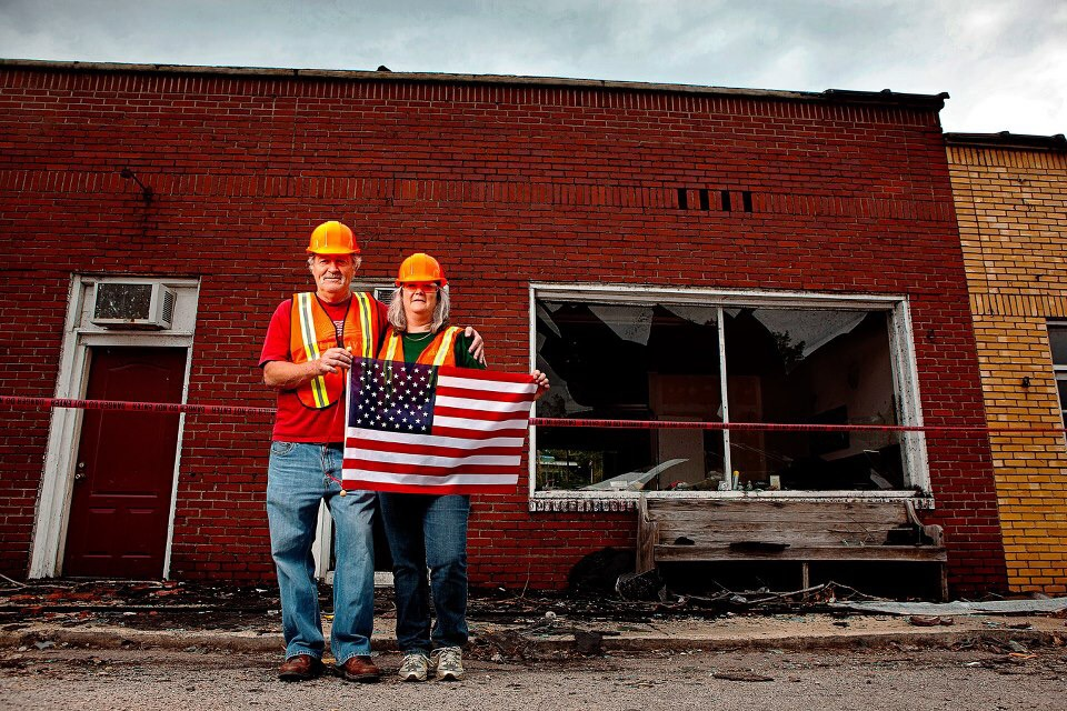 """I believe this couple owned the barber shop in town. His wife asked me, """"Can I grab my flag real quick? It was the only thing that survived."""""""