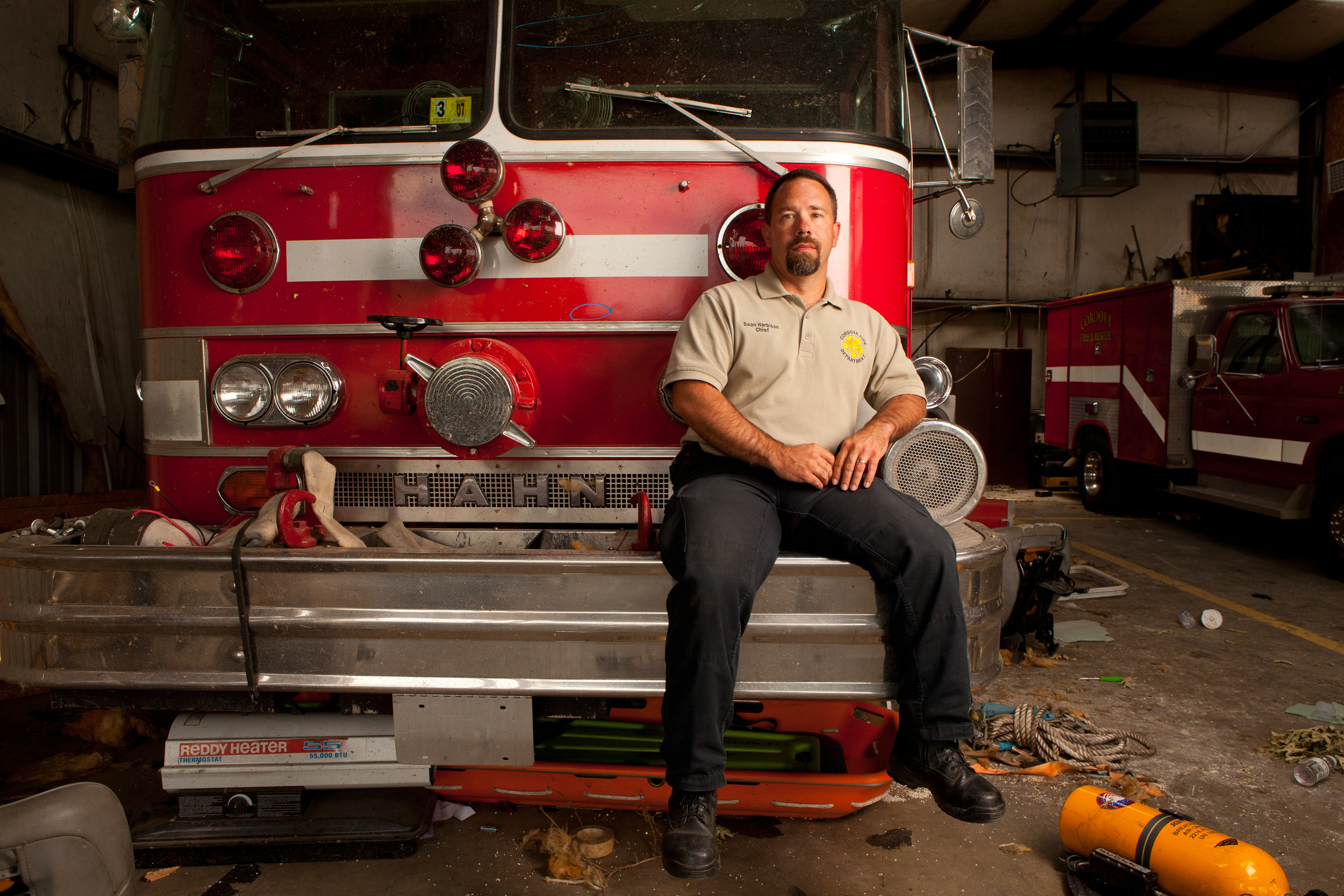 Dean, the Cordova Fire Chief. I'm told that the fire truck on which he is sitting was outside the station but got blown back inside and against the back wall...transmission was destroyed by flying objects and the engine may be totaled.