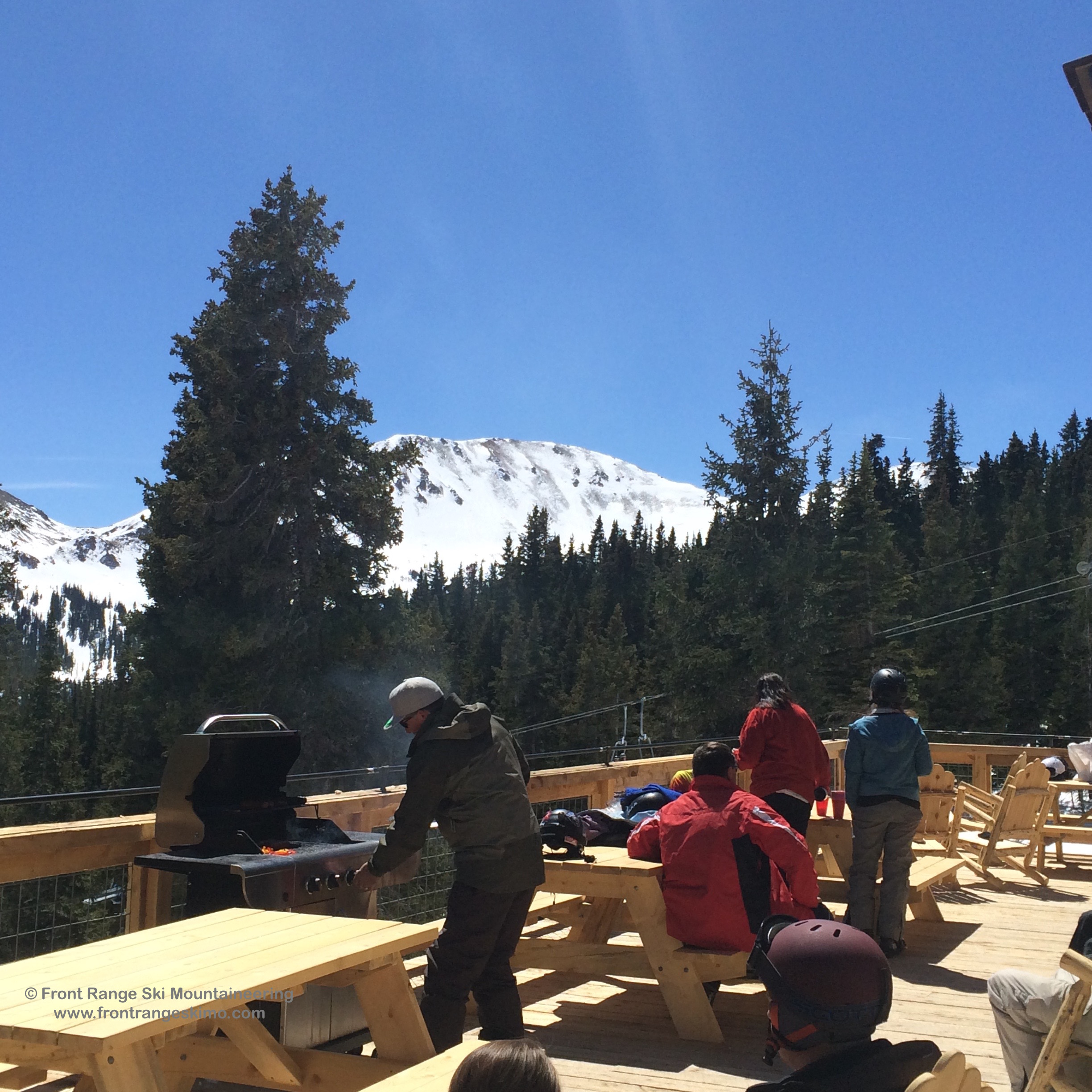 Grilling at Loveland Ski Area's Ginny Lee Cabin with the North Face of No Name in the background.
