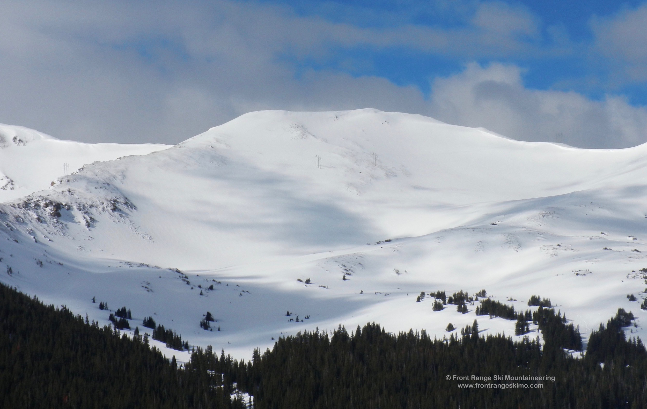 The South Twin 12,700' Peak at Jones Pass with Power Line Bowl in the middle of the slope.