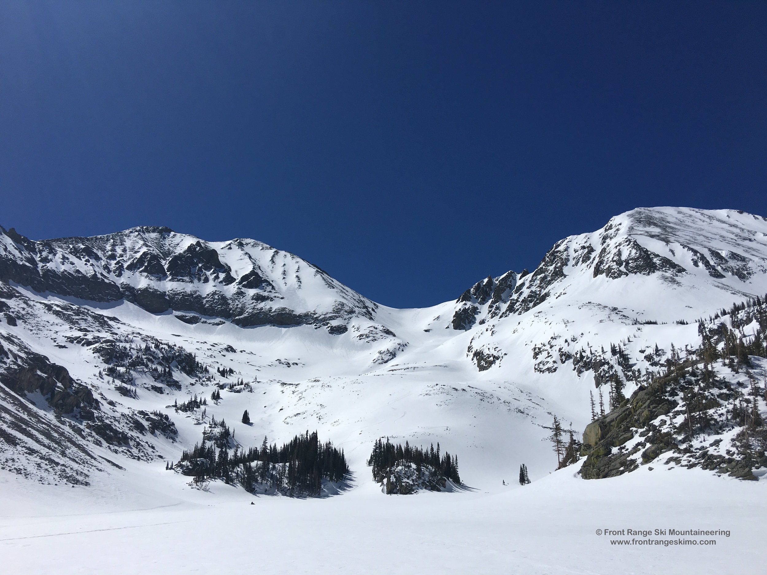 Looking up at Mounts Richthofen and Mahler from Lake Agnes.