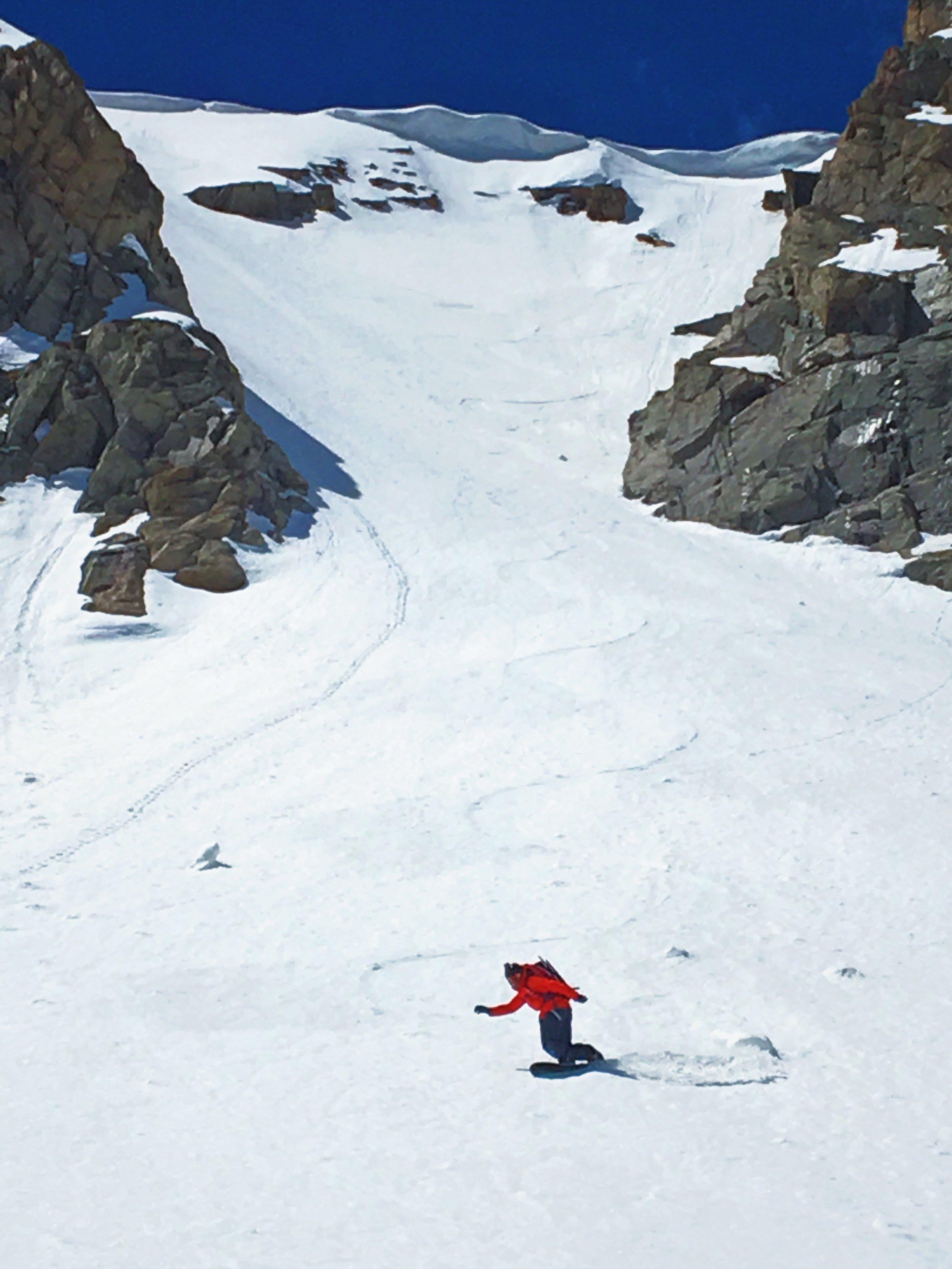 Riding the upper Peck Glacier's headwall.