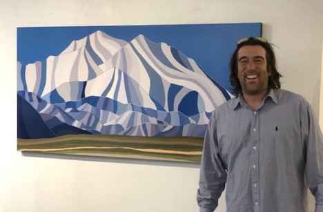 "Topher Straus(above) next to his piece: ""Denali National Park"""