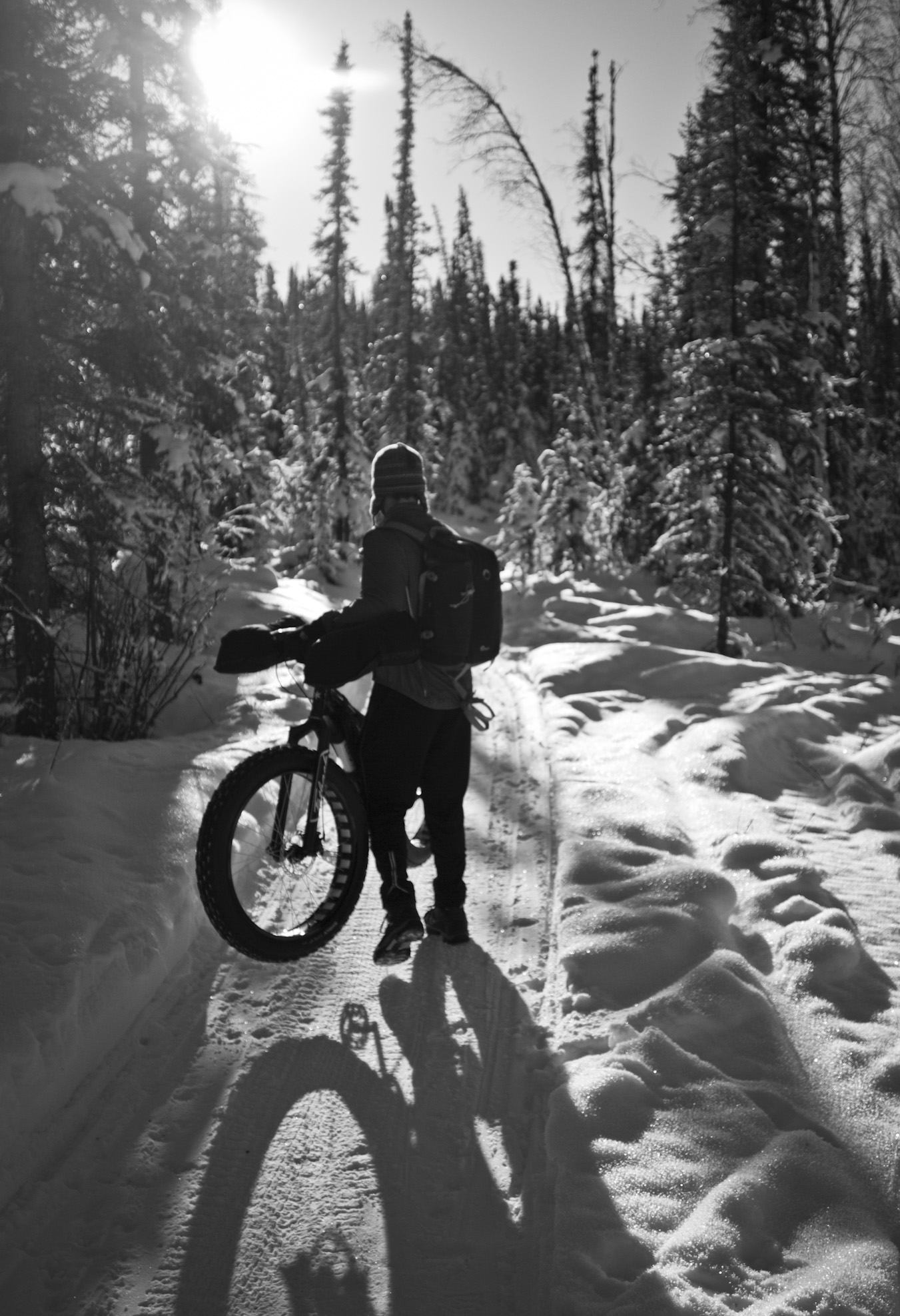 Colby Wright sets up his next bike photo in the warming rays of the late-winter sun. (c) Josh Spice 2014