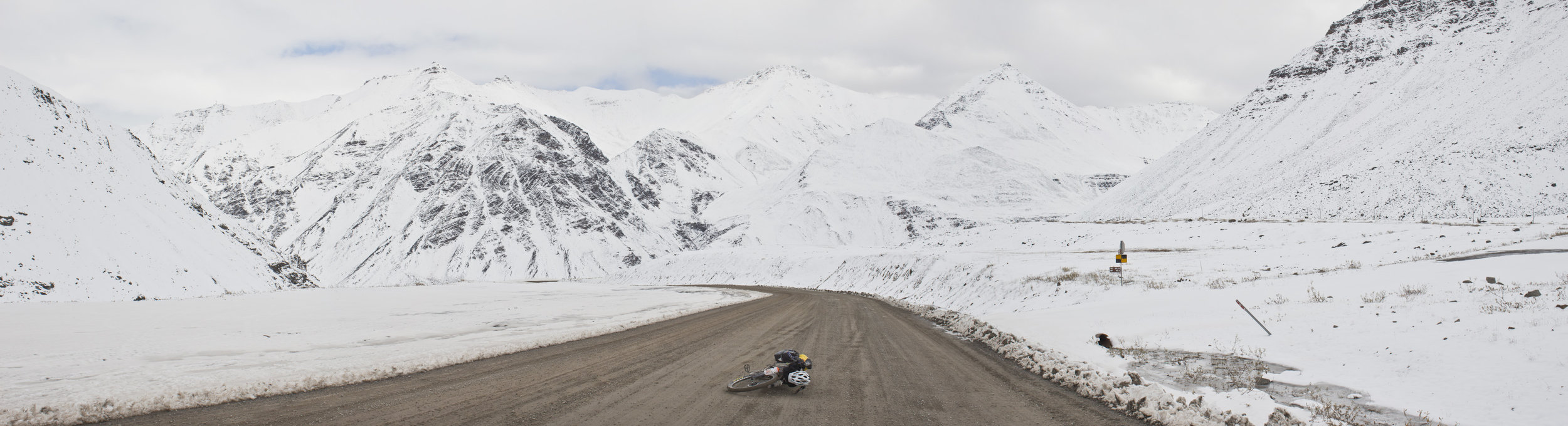 Atigun Pass in Alaska's Brooks Range. The highest pass on the Alaska road system and the northernmost mountains in North America. An early and unexpected fall snowstorm blanketed the mountains.