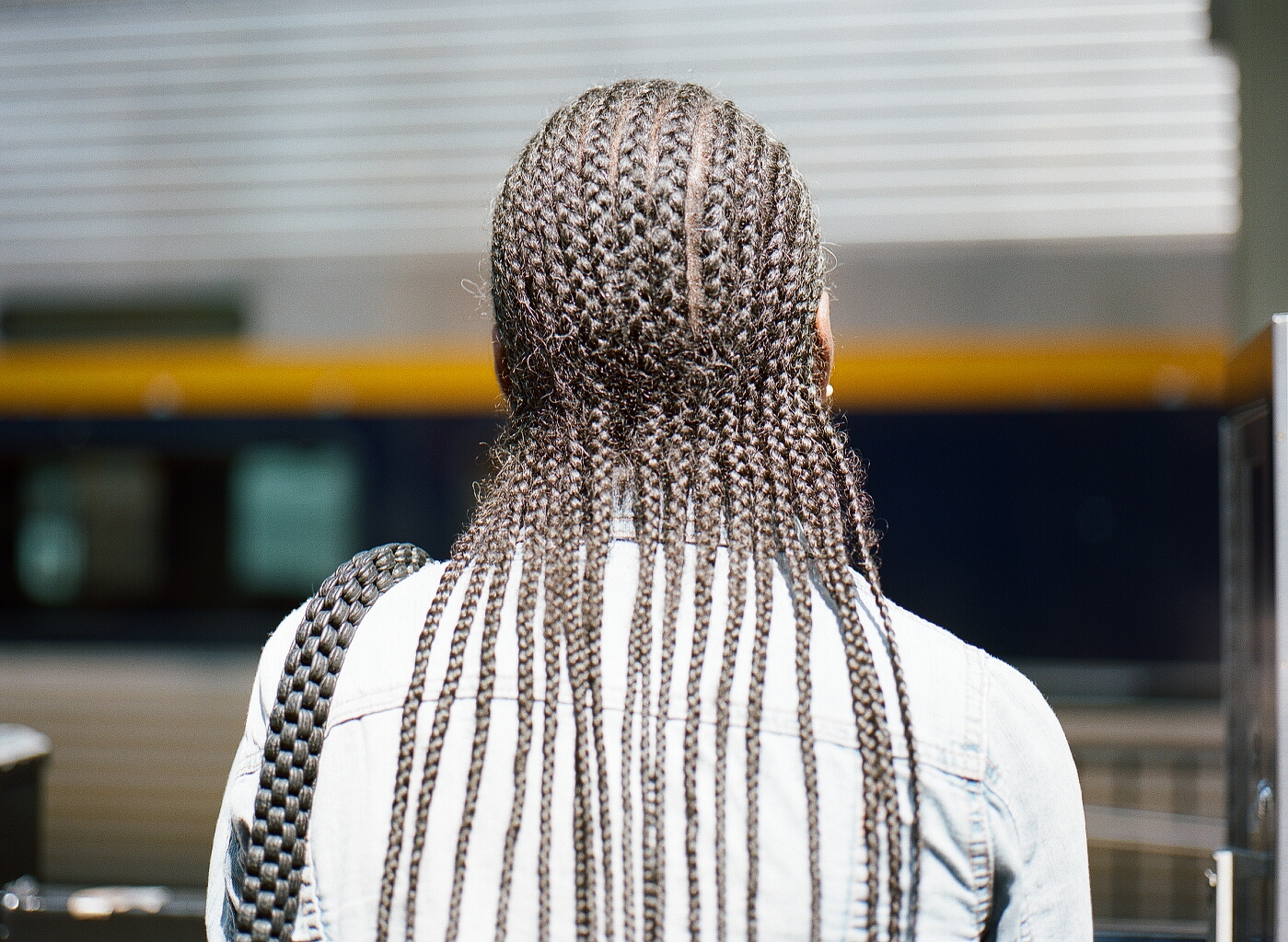- This is Denise. I met her while waiting for a train. She and I stood in the only patch of sun along the tracks. She saw me pull out my camera, laughed and said,