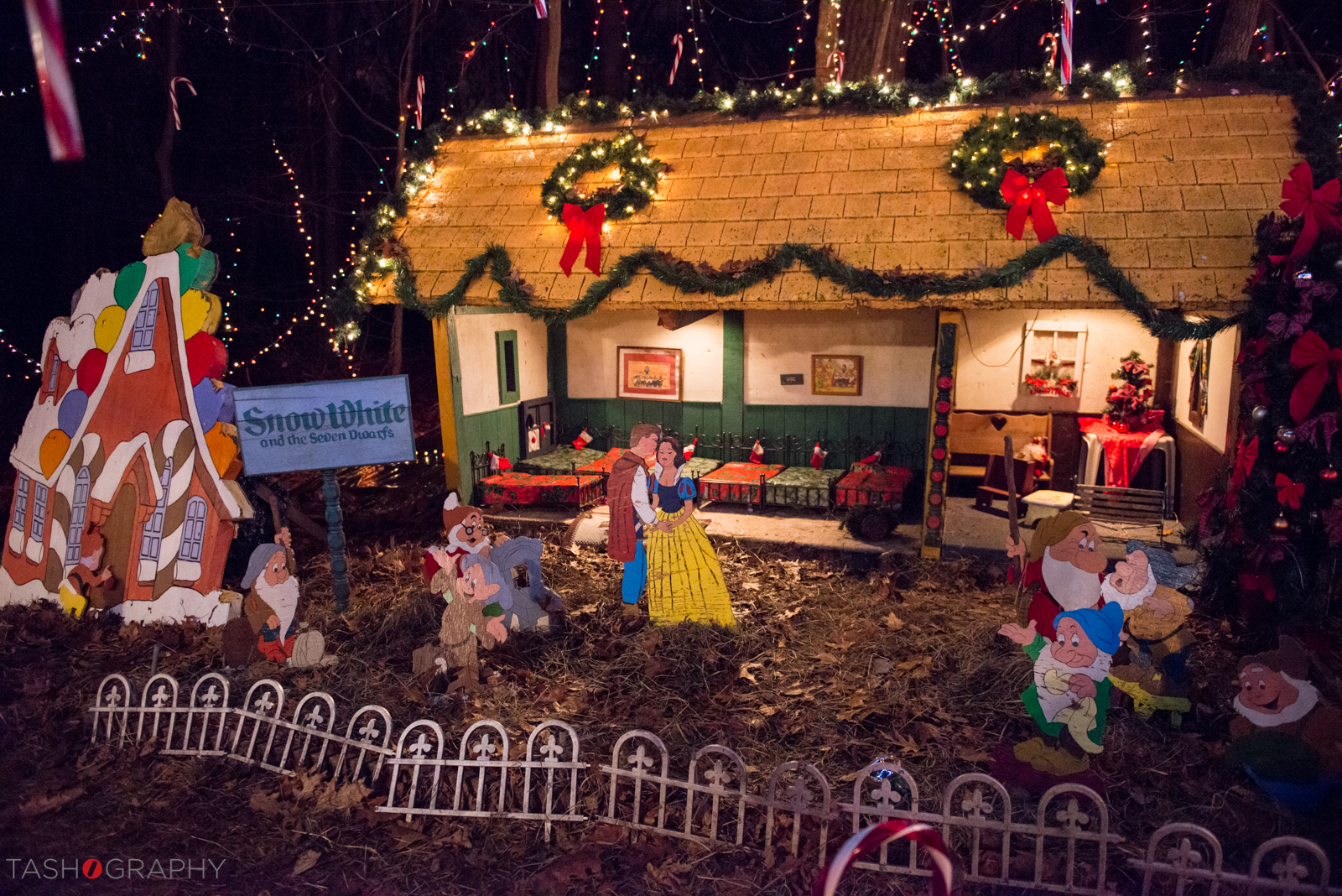 Here is oneof the hand-crafted houses in the village featuring Snow White and the Seven Dwarfs. Check out the little beds Mrs. Setti created using iron planters! All of the houses were built with recycled materials.