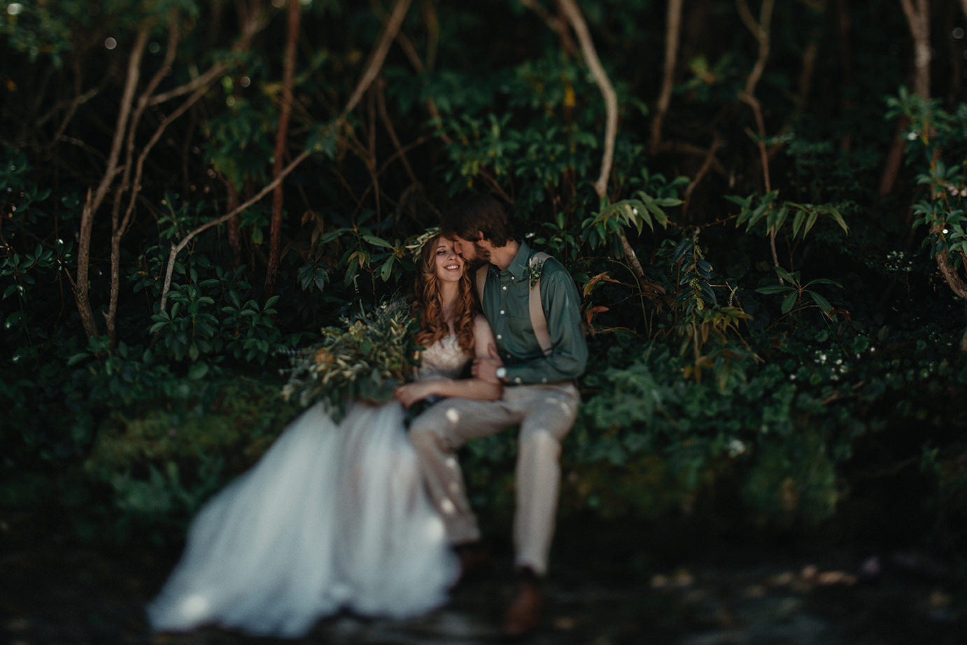 Bride and groom's wedding in the forest.