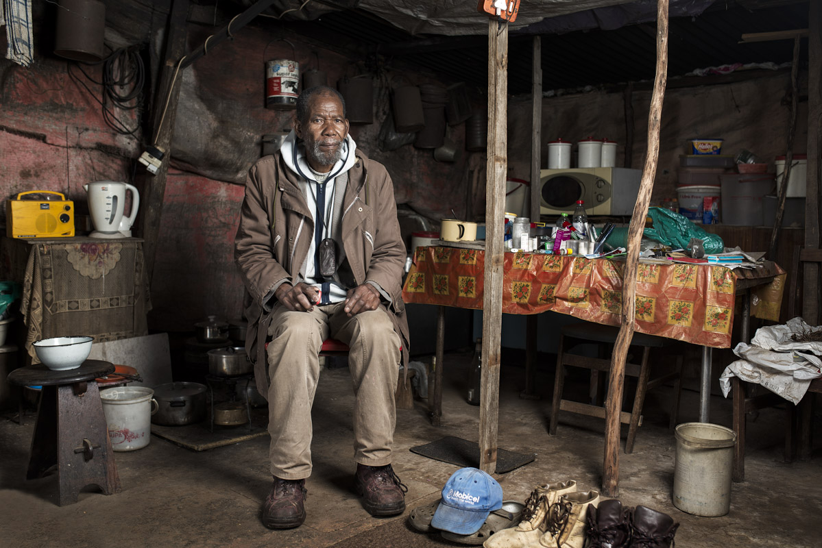 Zonisele Nkompela in his home outside Queenstown. He travels back to his family once a month.