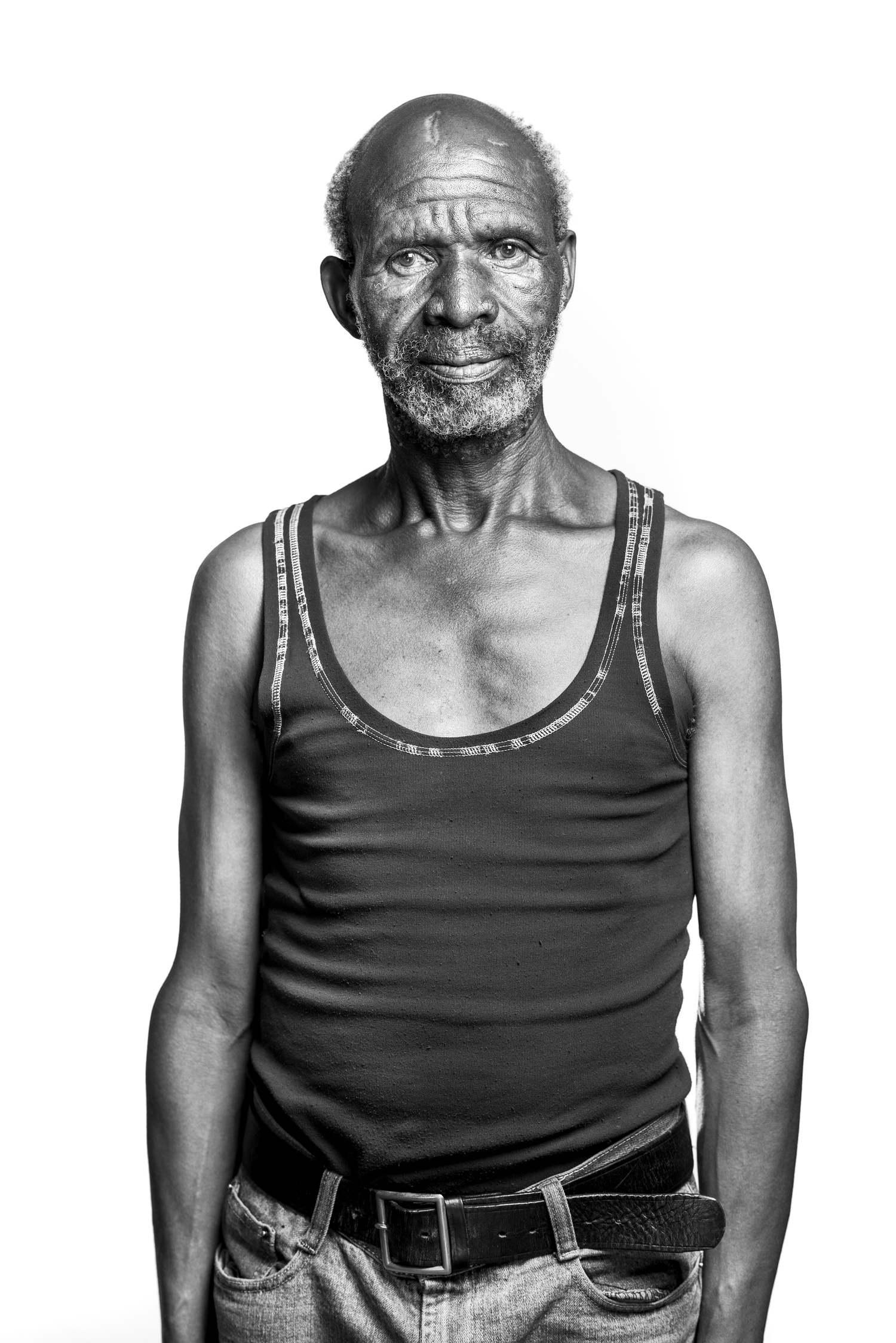 A portrait of Thembekile Mnahenitaken against the white background - 2015