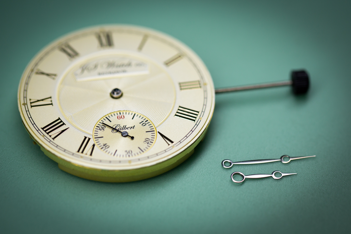 Dial and second and fitted, hour and minute hands prepared for bluing.