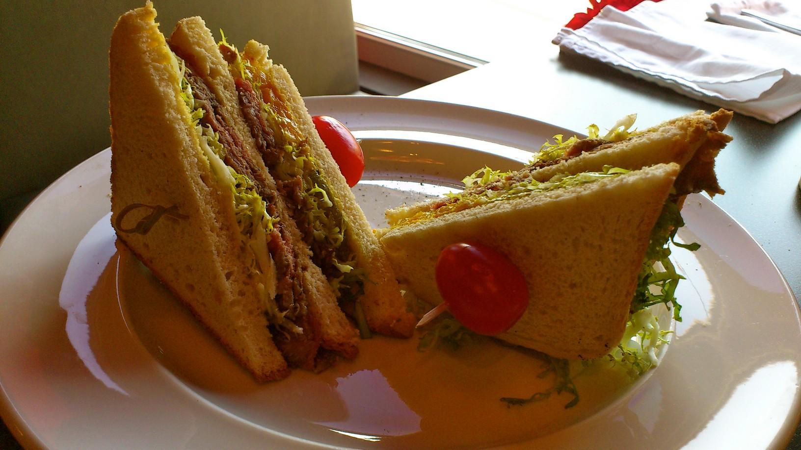 Beef castle club sandwich.