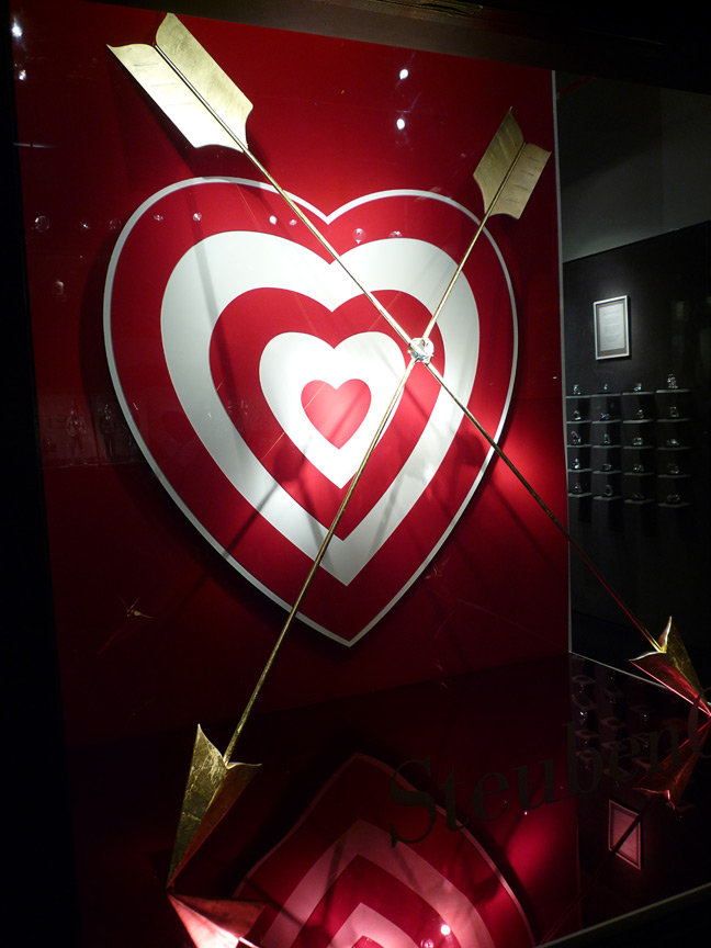 Giant heart target, golden arrows and backdrop designed and produced for Steuben Glass.