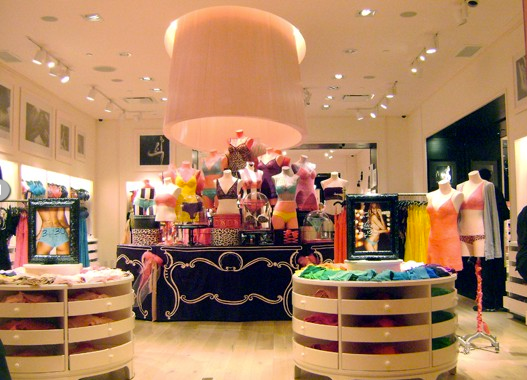 Giant ribbon wrapped lampshade, and hand painted table skirt produced for Victoria's Secret.