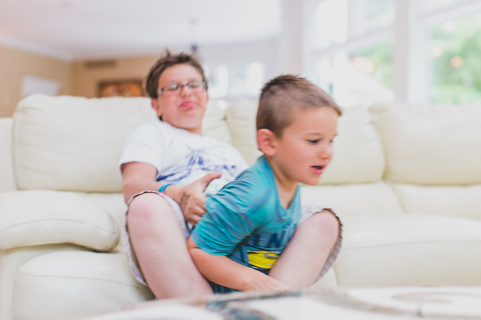 My ten year old loves to tickle his younger brother. Slow shutter speed to show motion blur.