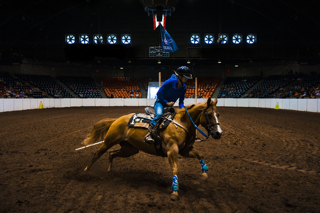 Riders prepare for the barrel racing competition during the Ohio State Fair at the Taft Coliseum on July 31, 2016.