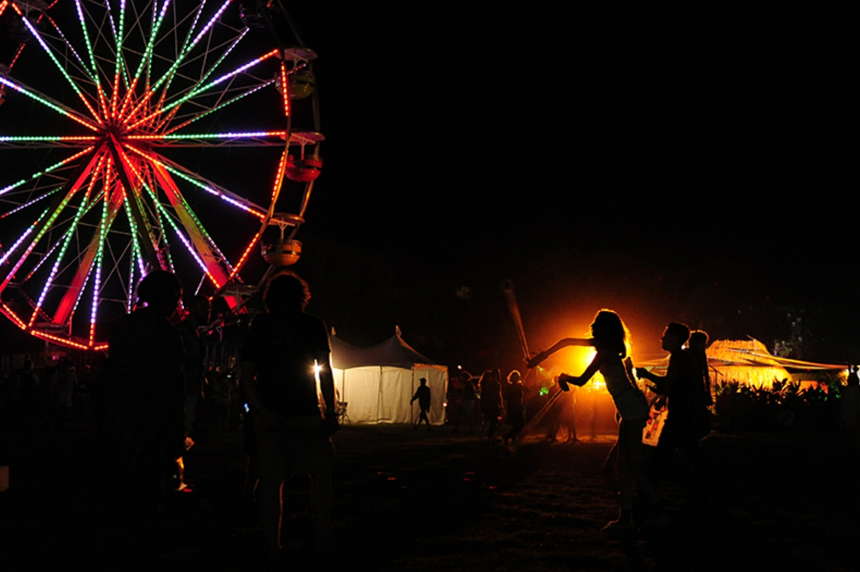 Concert-goers dance into the night during the Okeechobee Music Festival in Okeechobee, Fla., on March 5, 2016.