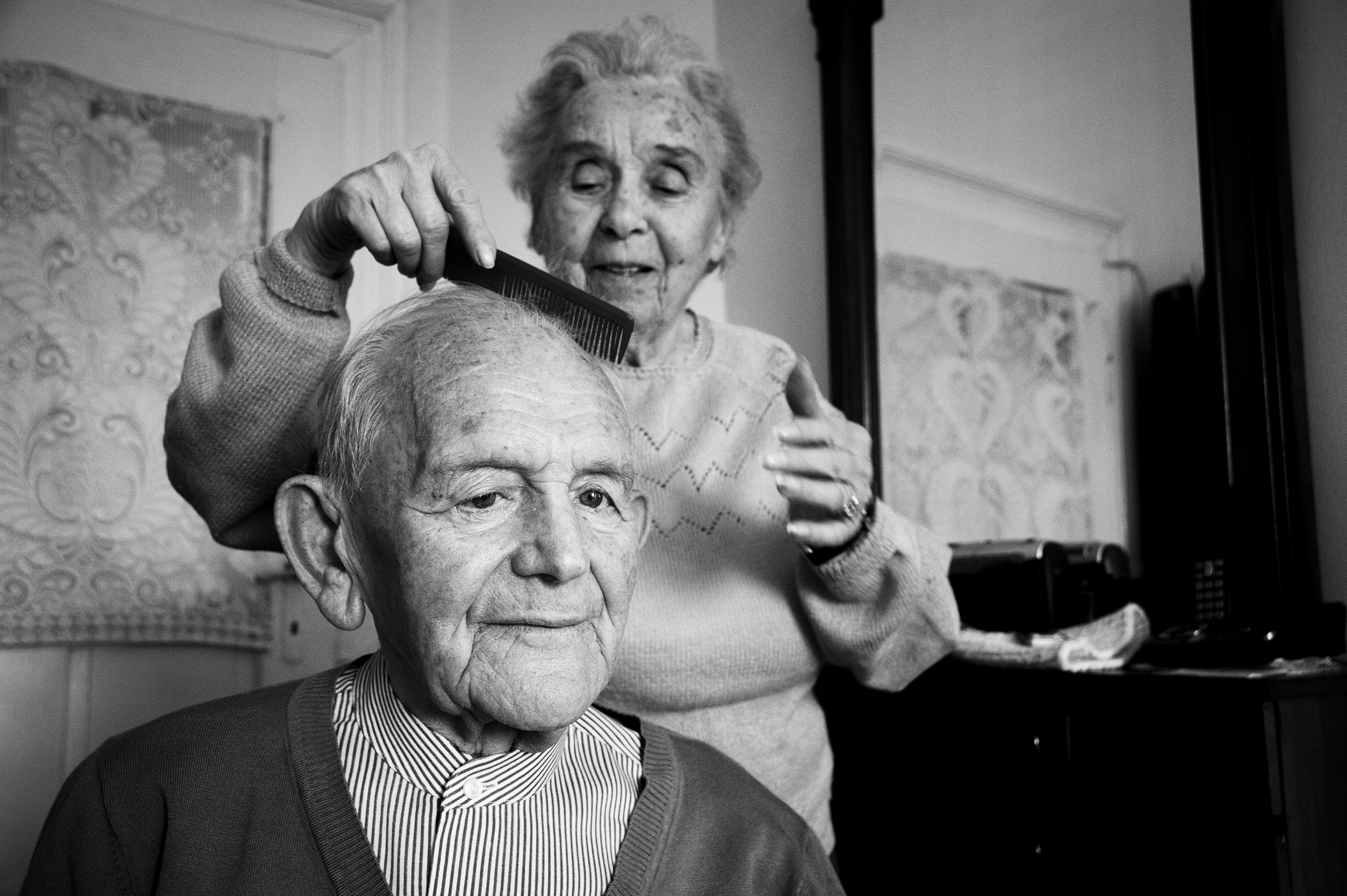 Elisabeta Steuer, 91, cares for her husband Ladislau, 94, at their home in downtown Oradea on January 16, 2015. Both survivors of the Holocaust, Ladislau was deported to a labor camp in Hungary while Elisabeta survived in a ghetto in the Romanian village of Ginta. They have been married for 66 years.