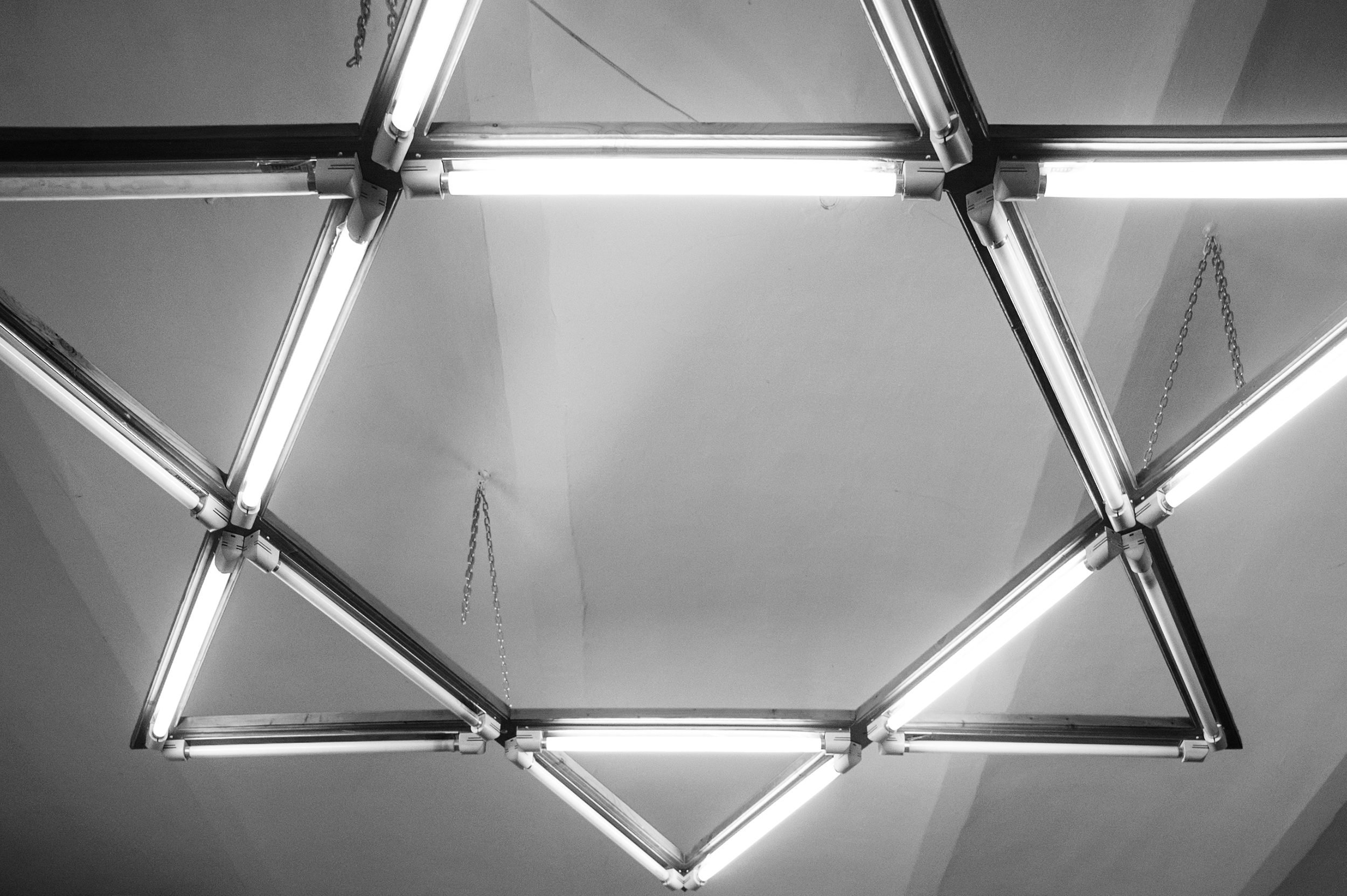 The Star of David-shaped flourescent lights flicker over the small meeting room inside the Jewish Community Center in Oradea, Romania on January 12, 2015.
