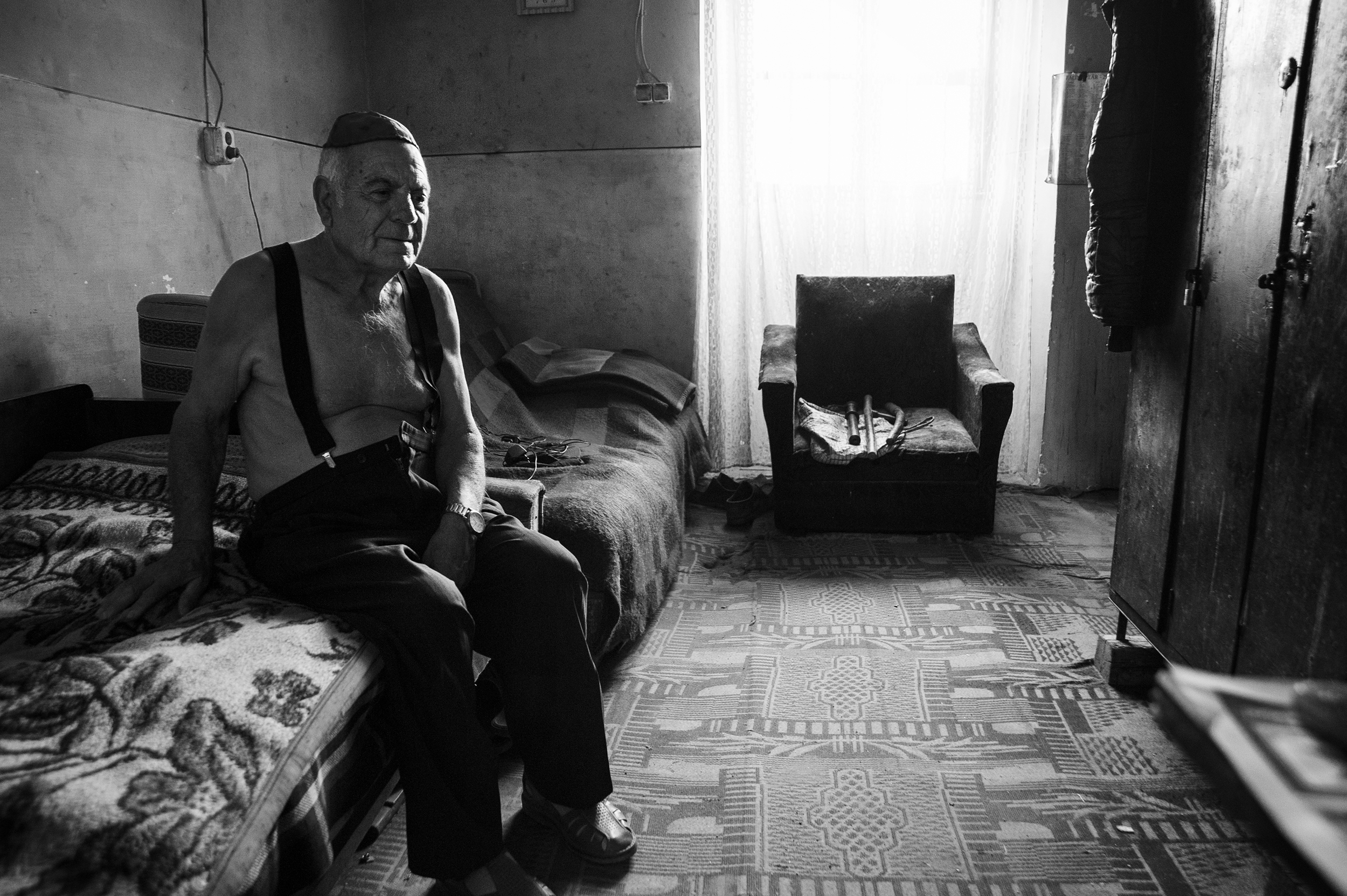 Alexandru Kepes, 79, a survivor of the Holocaust, sits in his small apartment in the back of the empty Zion Neologic Synagogue keeping watch of the sanctuary and scaring away any would-be vandals on August 19, 2013.