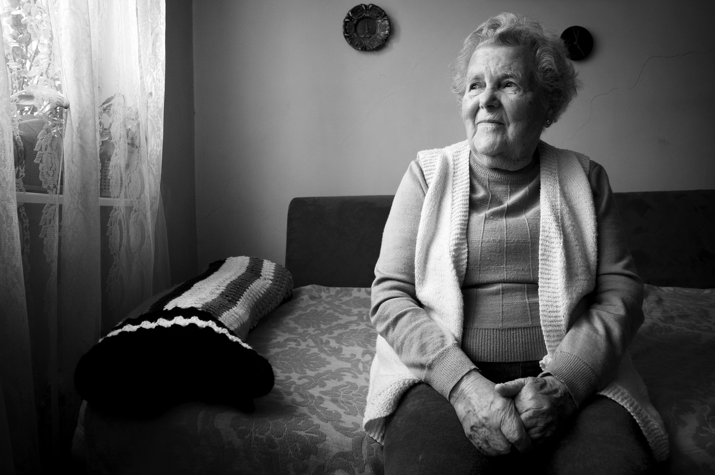 Vioara 'Ibby' Braun (Rosenzweig), 87, poses for a portrait in her home in Oradea, Romania on January 9, 2015. Born in Marghita, Romania, a town under Hungarian control during the war, Braun was deported at the age of seventeen to the Bergen Belsen concentration camp. She survived to be married her late husband, Tiberiu, an Auschwitz survivor. After the war, Braun would spend five years working for the Women's Anti-Fascist Union in Romania, and later as a secretary for the Women's Democratic Union