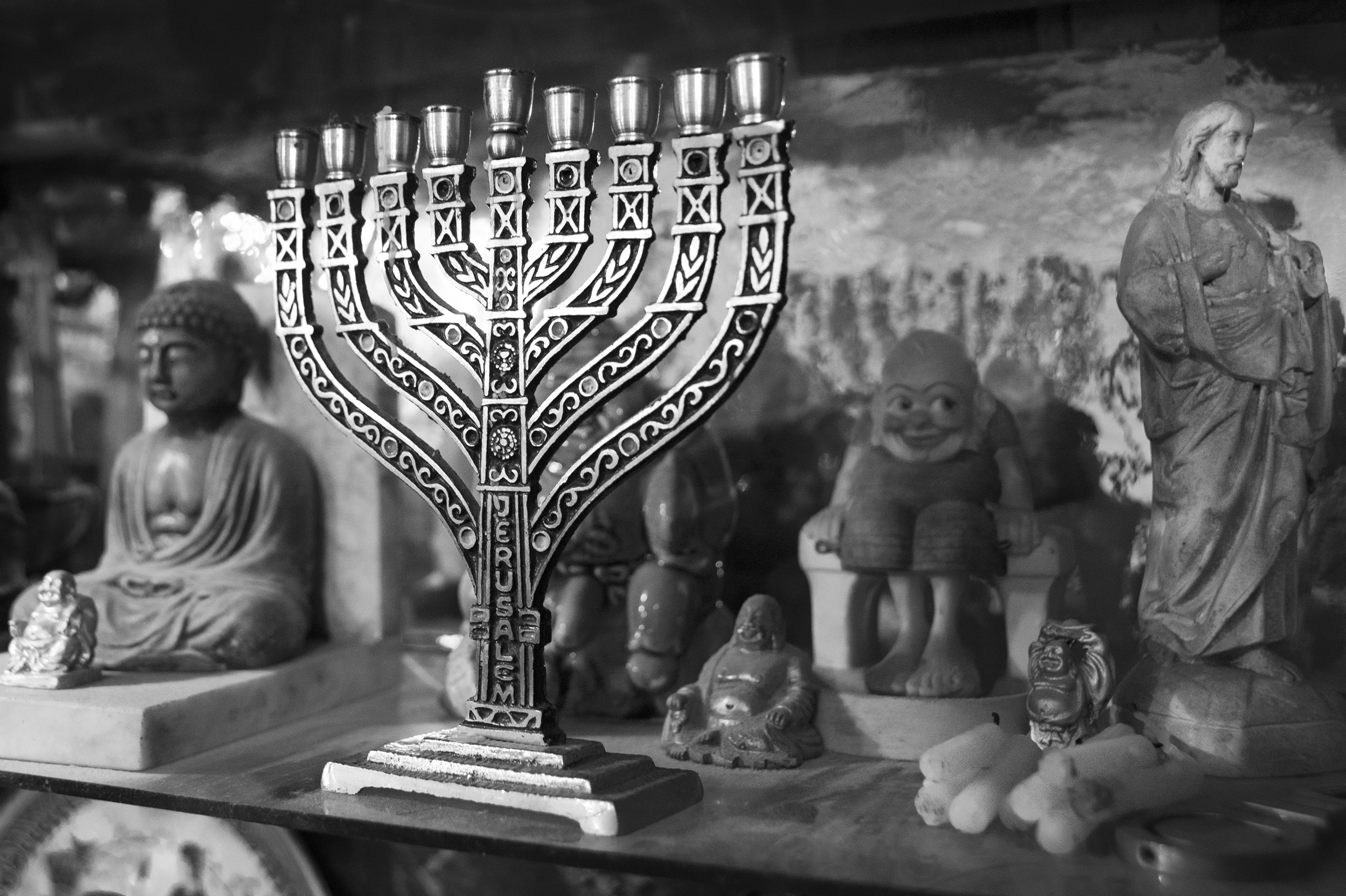 """The menorah stands on a crowded shelf in the home of Paul Spitzer (not pictured), the son of Holocaust survivor Amram Yehekztel on January 7, 2015. Though now a regular member at the community center in Oradea, Spitzer grew up without practicing the many religious traditions of Judaism, but credits his daughter with bringing him back to his roots. """"I believe the community has a future. I don't know how it will happen, but it's like a branch that has been broken, but the seed has survived."""" explains Spitzer."""